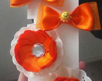 Orange clips with pearls