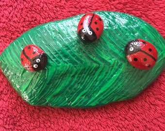 Painted stone - Leaf and ladybirds