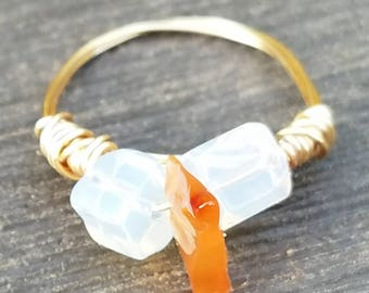 Gold ring with orange and clear stones