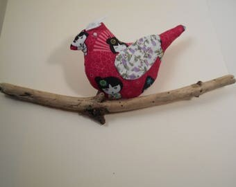 Small fabric Bird on a branch