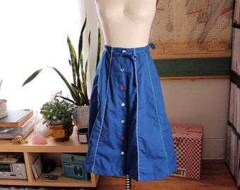 "blue vintage 1970s skirt . button down skirt with drawstring waist, mid length . 28"" waist"