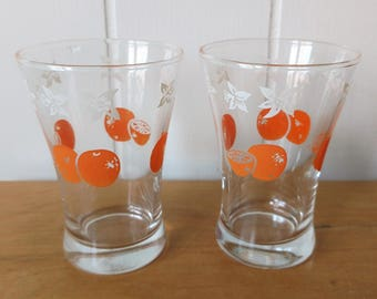 2 vintage orange juice glasses