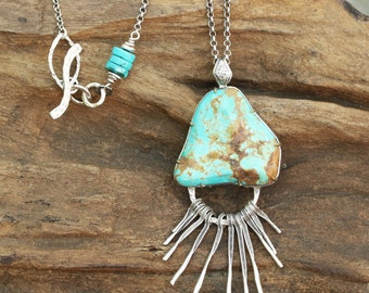 Large turquoise pendant necklace with silver finger dangles on oxidized silver chain