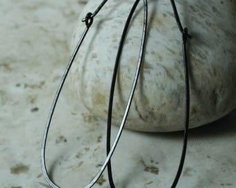 Handmade hammered extra large black enlongated oval hoop, one pair (item ID BK120G18L)