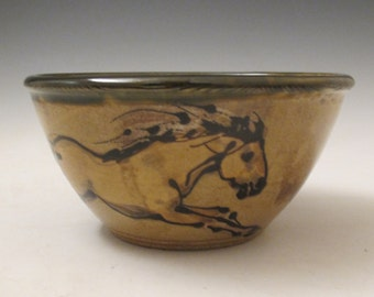 Bowl with  horses rustic slip trailed pottery