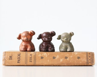 "Vintage Pup Paperweights, set of 3, one with ""BUCKI CARBON RIBBON"" Advertising"