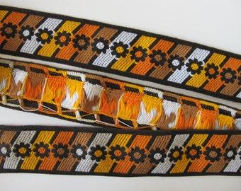 2 yards SPURS and GEARS vintage Jacquard trim in orange, tan, mustard, white on dark brown. 2 1/8 inch wide. V2042-B