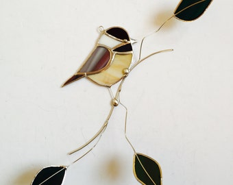 Chickadee stained glass suncatcher , bird on a 3 dimentional wire branch with green glass leaves .Realistic Bird.
