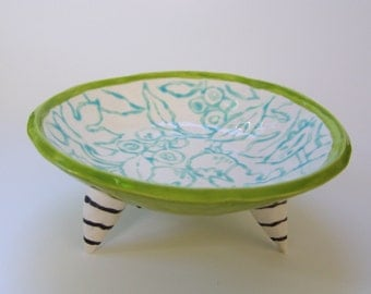 whimsical pottery Serving Bowl w/ lime green striped grinch feet, hand-painted light turquoise flowers & berries