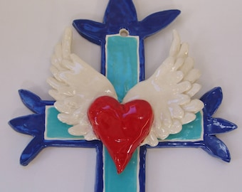 colorful ceramic Cross has a tattoo Heart with big wings fired in turquoise & navy blue