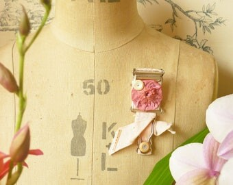 BROOCH Textile - vintage suspender and Suffolk Puff/Yo Yo