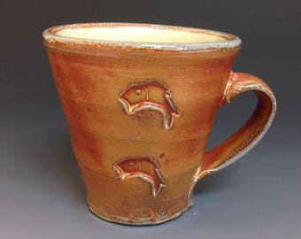 Coffee Mug with Jumping Fish. Trigger Handle. Soda Fired Stoneware Pottery.