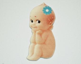 """Kewpie Shrink Plastic Brooch Pin - """"Perusing"""""""
