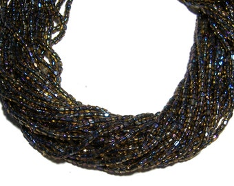 Topaz Black AB 2 tone lined 9/0 Seed Bead Hank