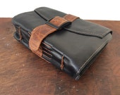 Belted black leather journal with handmade paper by Binding Bee