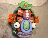 RESERVED FOR LORRAINE:  Ceramic Head, wall hanging, day of the dead, buddha