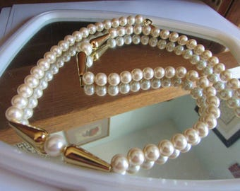 creamy pearl with gold tubes