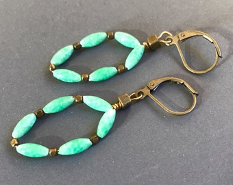 Beaded turquoise colored oval earrings