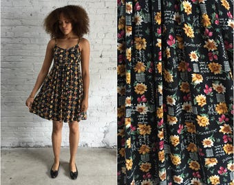 1990s grunge baby doll dress / 90s floral sunflower print dress / garden party spaghetti strap sundress