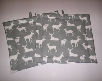 Set of 2 Potholders in Gray and White Buck fabric.