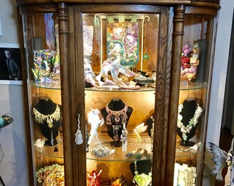 Antique Oak curved glass,Curio Display Cabinet clawed feet, lights, lock and key  (Pickup Only)