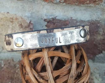 "Animal Print Cuff  with the word ""JOYFUL"" on hammered SIlver Metal-Quote"