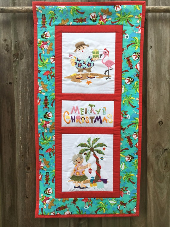 Tropical Merry Christmas embroidered and quilted wall hanging 14.5 x 29 Santa and Mrs. Claus