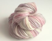 Hand dyed sock yarn. Snow Fairy. 100g of hand dyed superwash merino/nylon sock/fingering weight yarn. Variegated pastel pink, purple wool.