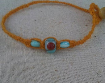 lampwork glass bracelet on rust orange hemp