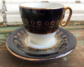 Vintage Demitasse teacup saucer Cobalt blue Czech Stamp Gold Gilt Sun Flowers