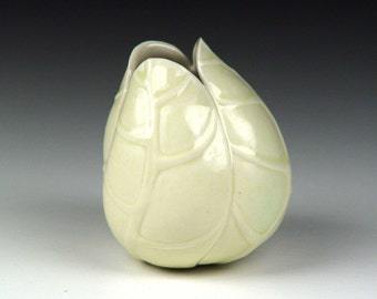 Tilted pale yellow porcelain ceramic pottery bud vase