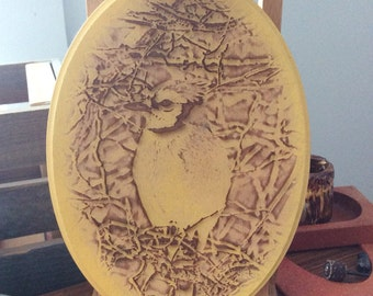 Blue jay laser engraving on oval wood plaque painted yellow
