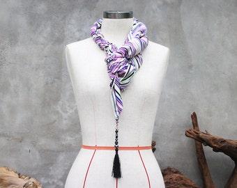 Purple striped scarf with beaded tassel charm