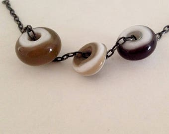 Three Amigos Lampworked Beads on Oxidized Sterling Silver