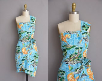 vintage 1950s dress. 50s one shoulder Hawaiian cotton vintage wiggle dress