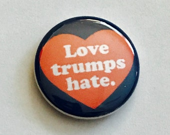 LOVE TRUMPS HATE pin back button, keychain, magnet or zipper pull