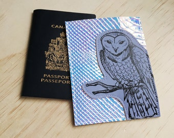 Sketchy Owl Passport Case made with holographic iridescent snakeskin fabric thats also Vegan
