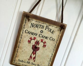 North Pole Candy Cane Co. Ornament | Christmas Holiday | Bow | Snowflake | Hanging Wood Sign | Vintage | Altered Art | Red White | Handmade