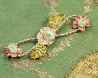 Antique silk ribbonwork piece pale pink blue shade rolled rose metal trim leaves center  original new old stock french dolls tiny  flowers