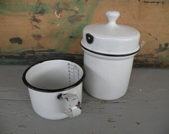 2 pcs. white vintage enamelware cup w/ measures and small canister , nice kitchen ware Blue & black trim