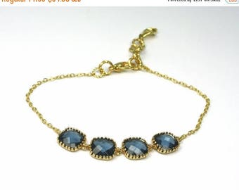 20% off. navy blue bracelet with square framed and faceted  briolettes in gold bezel settings geometric and delicate