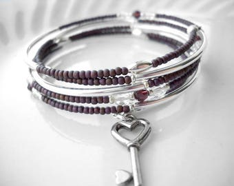 Beaded memory wire bracelet: New Dreams Tonight | Silver key charm | Burgundy bracelet | Purple bracelet | Silver tube bracelet | Heart
