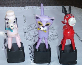 3 Retro Push Up Toys. Early Plastic. Pink Dog, Purple Cat and Red Horse. Made in Hong Kong. Dancing Puppets.