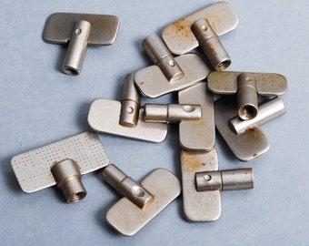 Set of 10 vintage miniature keys winding alarm clock.