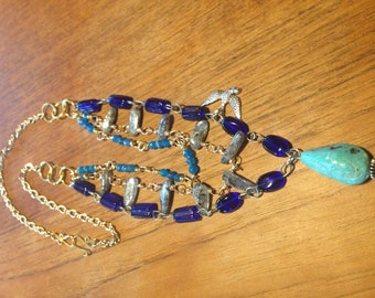 Natural Arizona turquoise pendant in a triple strand necklace.