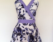 Retro apron crossed with flared skirt, blue floral pattern on a white fabric. 1950s inspired, fully lined.