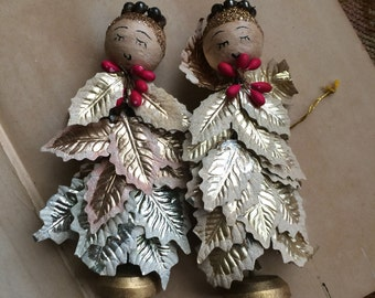 This Pair Of Angels Is Setting A New Style With Their Glitter Foil Leaf Dresses