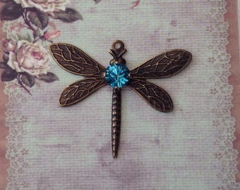 1 Antique brass dragonfly with a Swarovski crystal stone, in Indicolite.