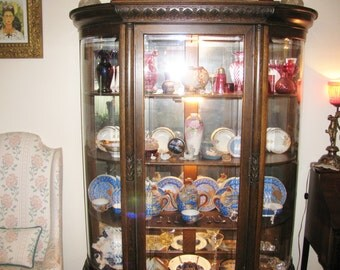 Victorian golden oak china cabinet refinished dark with tall clawfoot legs