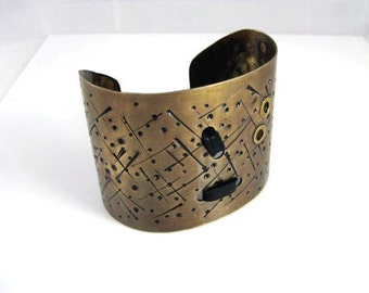 Brass  Wide   Bracelet. Cuff. Unique textured  finishing with leather.  Brass is the new black.